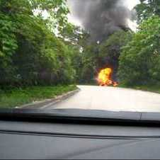 Nissan GTR R35 on fire after crashing with VW Golf.